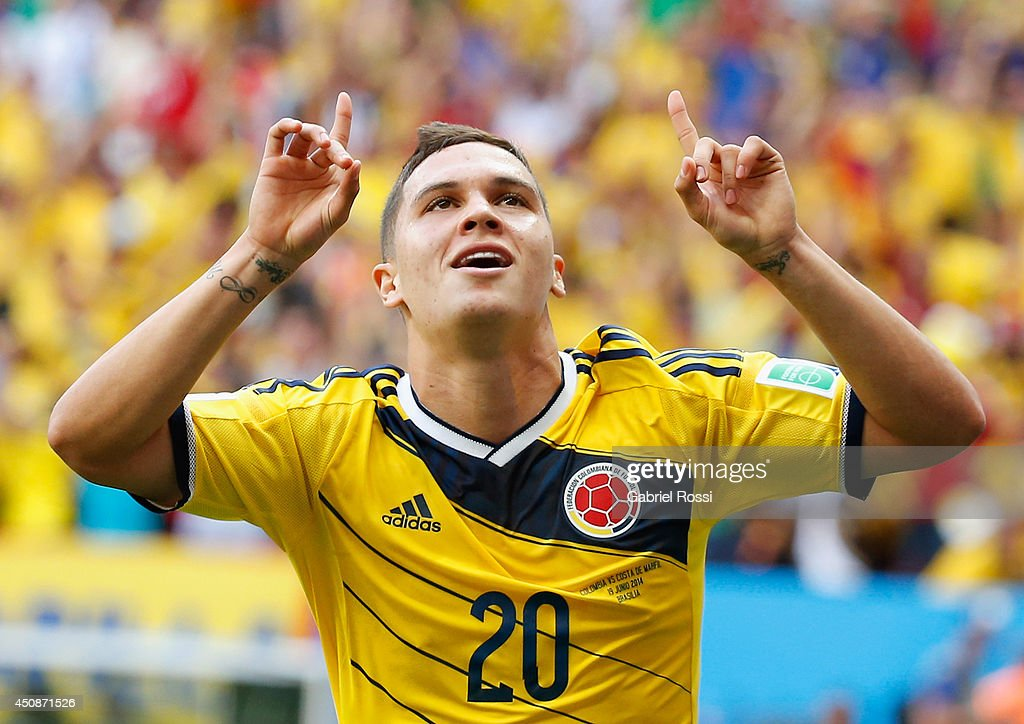 Juan Fernando Quintero of Colombia celebrates after scoring his team's second goal during the 2014 FIFA World Cup Brazil Group C match between...