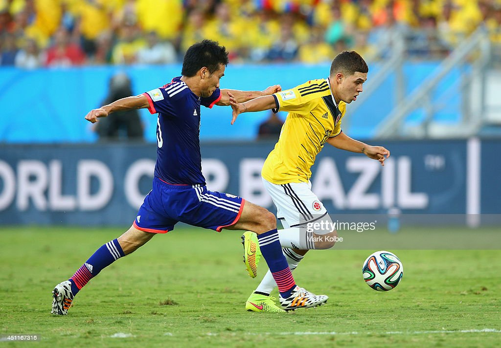 Juan Fernando Quintero of Colombia controls the ball as Yasuyuki Konno of Japan gives chase during the 2014 FIFA World Cup Brazil Group C match...