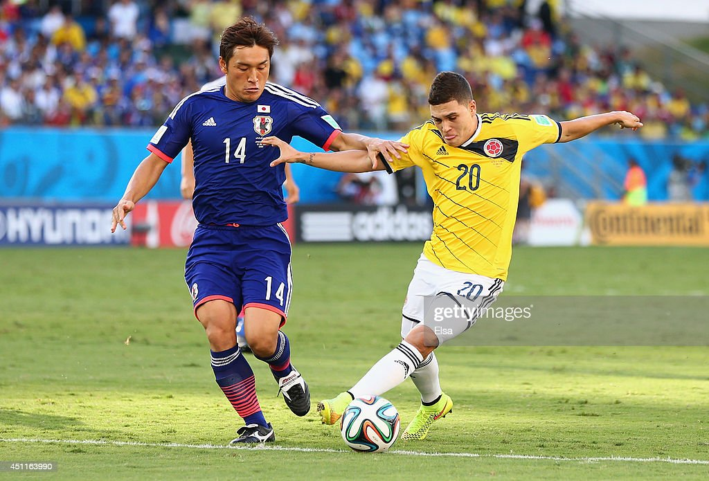 <a gi-track='captionPersonalityLinkClicked' href=/galleries/search?phrase=Juan+Fernando+Quintero&family=editorial&specificpeople=9630789 ng-click='$event.stopPropagation()'>Juan Fernando Quintero</a> of Colombia holds off <a gi-track='captionPersonalityLinkClicked' href=/galleries/search?phrase=Toshihiro+Aoyama&family=editorial&specificpeople=3971824 ng-click='$event.stopPropagation()'>Toshihiro Aoyama</a> of Japan during the 2014 FIFA World Cup Brazil Group C match between Japan and Colombia at Arena Pantanal on June 24, 2014 in Cuiaba, Brazil.