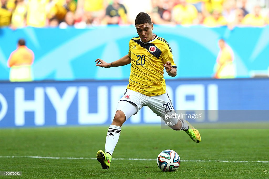 <a gi-track='captionPersonalityLinkClicked' href=/galleries/search?phrase=Juan+Fernando+Quintero&family=editorial&specificpeople=9630789 ng-click='$event.stopPropagation()'>Juan Fernando Quintero</a> of Colombia scores his team's second goal during the 2014 FIFA World Cup Brazil Group C match between Colombia and Cote D'Ivoire at Estadio Nacional on June 19, 2014 in Brasilia, Brazil.