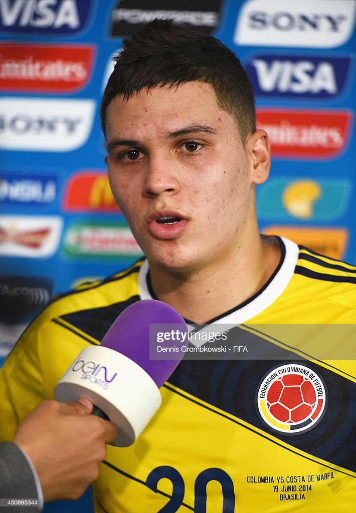 Juan Fernando Quintero of Colombia talks to a reporter in the mixed zone after the 2014 FIFA World Cup Brazil Group C match between Colombia and Cote...