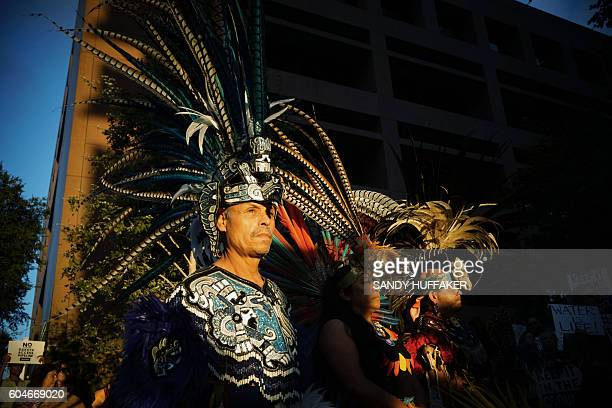 Juan Flores a traditional Aztec dancer looks on during a rally on September 13 2016 in San Diego California in support for the protestors at Standing...