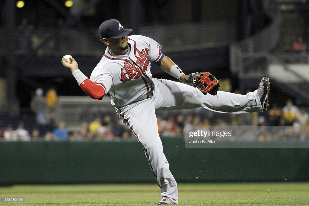 Juan Francisco #25 of the Atlanta Braves fields a ground ball against the Pittsburgh Pirates during the game on October 2, 2012 at PNC Park in Pittsburgh, Pennsylvania.