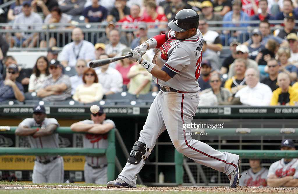 Juan Francisco #25 of the Atlanta Braves scores a run on a ground out in the sixth inning against the Pittsburgh Pirates during the game on October 3, 2012 at PNC Park in Pittsburgh, Pennsylvania.