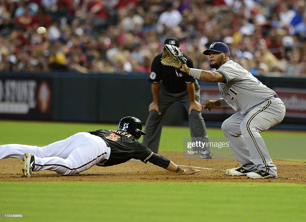 Juan Francisco #21 of the Milwaukee Brewers waits for the ball as <a gi-track='captionPersonalityLinkClicked' href=/galleries/search?phrase=Gerardo+Parra&family=editorial&specificpeople=4959447 ng-click='$event.stopPropagation()'>Gerardo Parra</a> #8 of the Arizona Diamondbacks dives back to first base at Chase Field on July 14, 2013 in Phoenix, Arizona.
