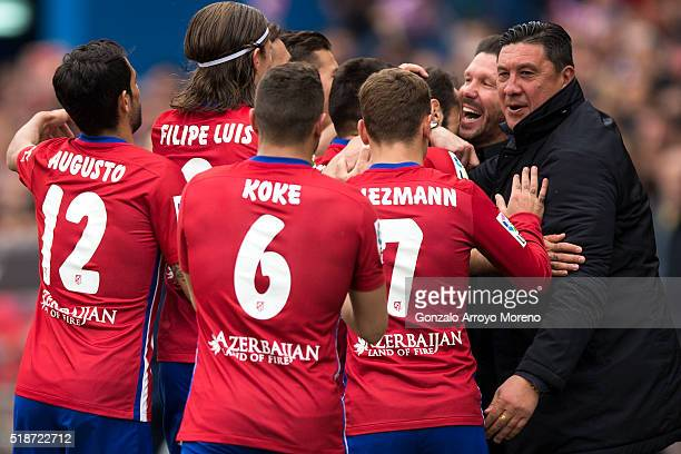 Juan Francisco Torres alias Juanfran of Atletico de Madrid celebrates scoring their third goal with coach Diego Pablo Simeone assistant coach German...