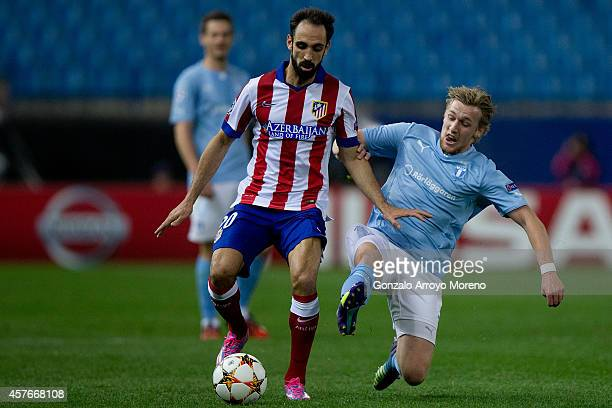 Juan Francisco Torres alias Juanfran of Atletico de Madrid competes for the ball with Emil Forsberg of Malmo FF during the UEFA Champions League...