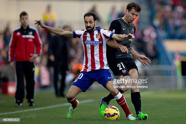 Juan Francisco Torres alias Juanfran of Atletico de Madrid competes for the ball with Andreas Ivanschitz of Levante UD during the La Liga match...