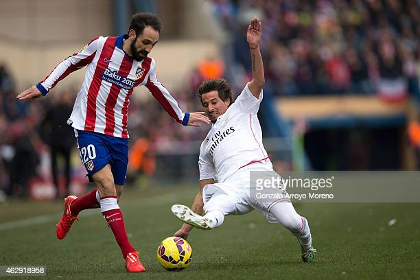 Juan Francisco Torres alias Juanfran of Atletico de Madrid competes for the ball with Fabio Coentrao of Real Madrid CF during the La Liga match...
