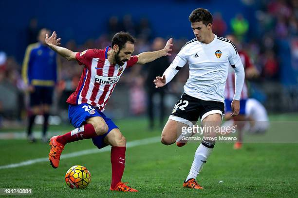 Juan Francisco Torres alias Juanfran of Atletico de Madrid competes for the ball with Santi Mina of Valencia CF during the La Liga amtch between Club...