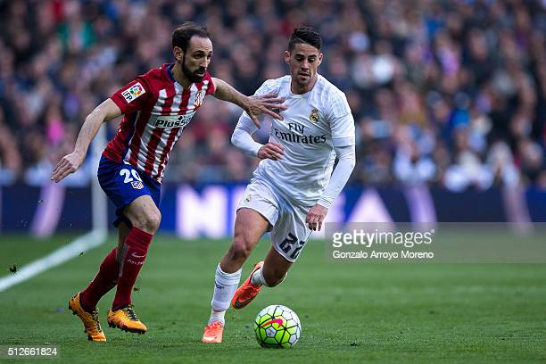 Juan Francisco Torres alias Juanfran of Atletico de Madrid competes for the ball with Francisco Roman Alarcon alias Isco of Real Madrid CF during the...