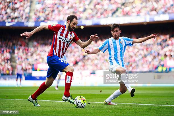 Juan Francisco Torres alias Juanfran of Atletico de Madrid competes for the ball with Ricardo Horta of Malaga CF during the La Liga match between...