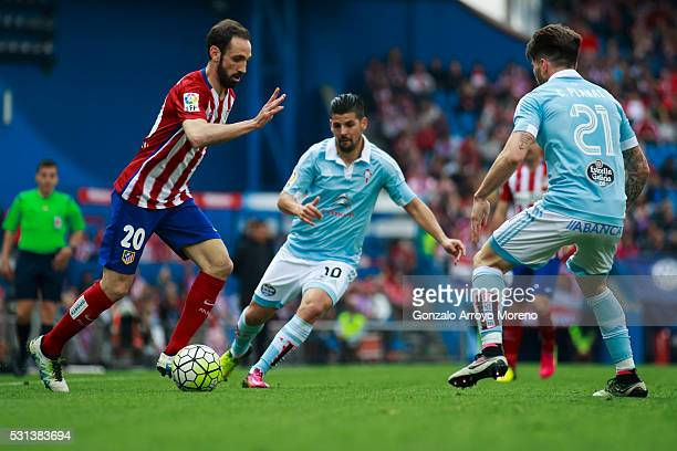 Juan Francisco Torres alias Juanfran of Atletico de Madrid competes for the ball with Manuel Agudo Duran alias Nolito of RC Celta de Vigo and his...