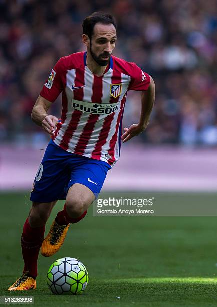 Juan Francisco Torres alias Juanfran of Atletico de Madrid controls the ball during the La Liga match between Real Madrid CF and Club Atletico de...