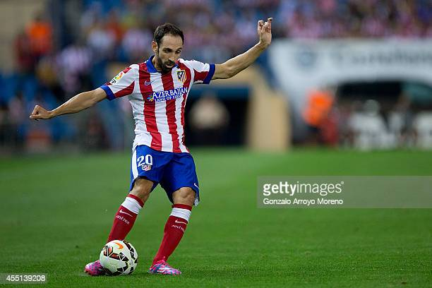 Juan Francisco Torres alias Juanfran of Atletico de Madrid strikes the ball during the La Liga match between Club Atletico de Madrid and SD Eibar at...