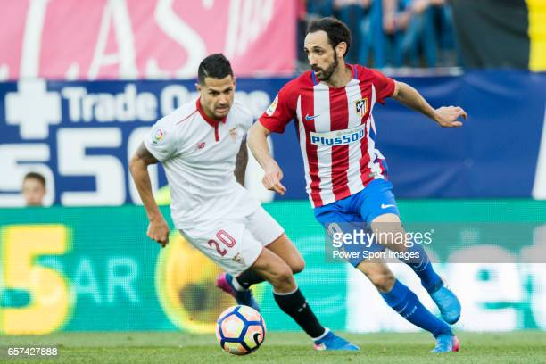 Juan Francisco Torres Belen Juanfran of Atletico de Madrid fights for the ball with Victor Machin Perez Vitolo of Sevilla FC during their La Liga...
