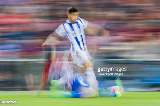 Juan Francisco Torres Belen Juanfran of Atletico de Madrid fights for the ball with Yuri Berchiche Izeta of Real Sociedad during their La Liga match...