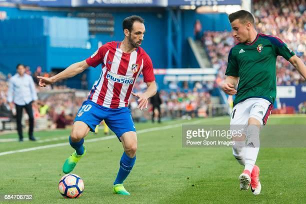 Juan Francisco Torres Belen Juanfran of Atletico de Madrid in action against Alex Berenguer Remiro of Osasuna during the La Liga match between...