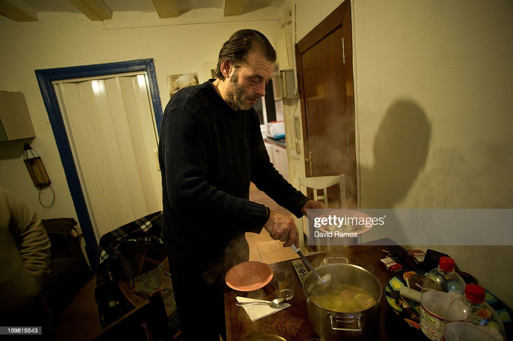 Juan from Spain, 50, serves soup for his dinner at the end of the day in the apartment rent by Wolfgang Striebinger for giving a bed to the volunteers of the 'El Chiringuito de Dios' ('the Stall of God') on January 14, 2013 in Barcelona, Spain. The German pastor Wolfgang Striebinger has lived in Barcelona since 1991, originally employed to minister to youths during the Barcelona Olympic Games, he decided to stay and since 2000 has run 'El Chinguito de Dios' (The Stall of God). In his mission to support the homeless, Wolfgang and his volunteers offer a place for up to 200 people to come and have some food daily and also offering them assistance with grooming and clothes. Many of the volunteers are homeless and help out in return for meals and a bed. Wolfgang's ethos is to provide peace, calm and dignity to all those that need it amongst Barcelona's burgeoning homeless population. Due to the economic situation his doors are now also open to the long term unemployed and families with little or no income. According to the latest figures 21.8% of the Spanish populations are living below the poverty line.