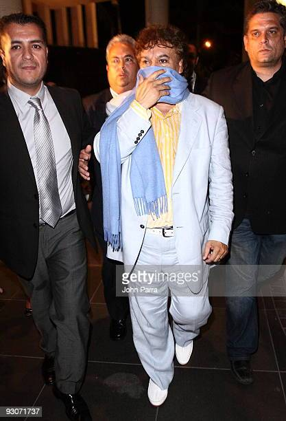 Juan Gabriel covers his mouth as he leaves from performing at Sammy Sosa's birthday party at Fontainebleau Miami Beach on November 14 2009 in Miami...