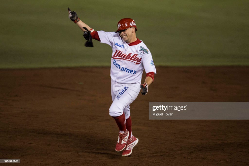 Juan Gamboa celebrates after a home run to win the championship between Pericos de Puebla and Diablos Rojos as part of Serie del Rey Mexican Baseball...