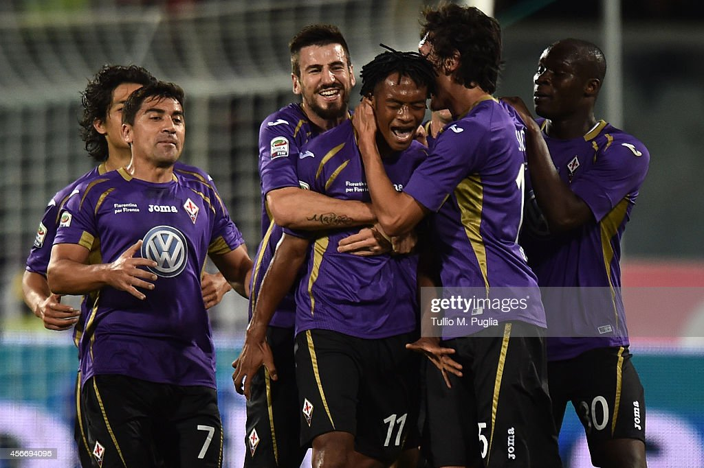 Juan Gillermo Quadrado (C) of Fiorentina celebrates with team mates after scoring his team's second goal during the Serie A match between ACF Fiorentina and FC Internazionale Milano at Stadio Artemio Franchi on October 5, 2014 in Florence, Italy.