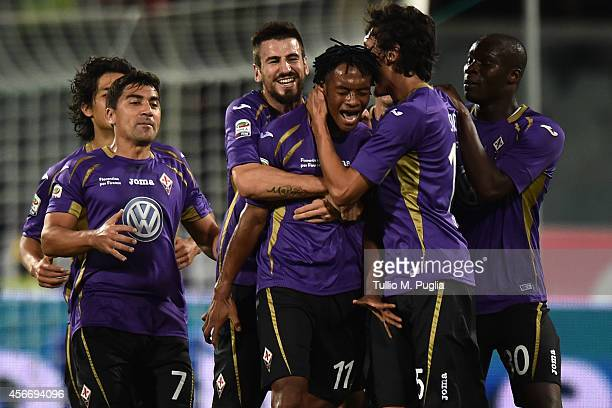 Juan Gillermo Quadrado of Fiorentina celebrates with team mates after scoring his team's second goal during the Serie A match between ACF Fiorentina...