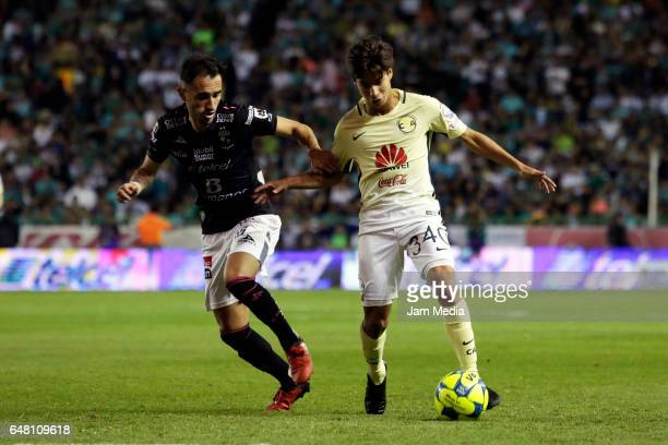 Juan Gonzalez of Leon and Diego Lainez of America fight for the ball during the 9th round match between Leon and America as part of the Torneo...