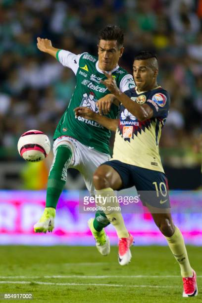 Juan Gonzalez of Leon fights for the ball with Cecilio Dominguez of America during the 11th round match between Leon and America as part of the...