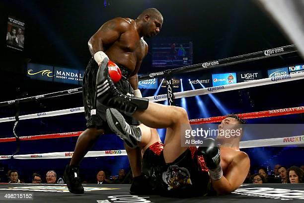 Juan Goode knocks down Zhang Zhilei during their heavyweight fight at the Mandalay Bay Events Center on November 21 2015 in Las Vegas Nevada