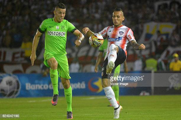 Juan Guilermo Dominguez of Atletico Junior vies for the ball with Mateus Uribe of Atletico Nacional during the Final match between Junior and...