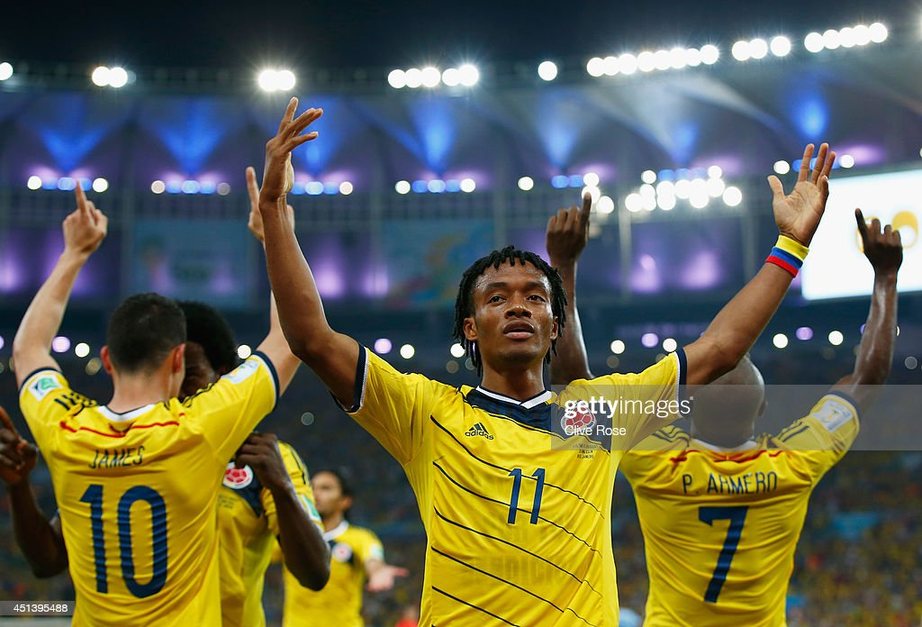 <a gi-track='captionPersonalityLinkClicked' href=/galleries/search?phrase=Juan+Guillermo+Cuadrado&family=editorial&specificpeople=6912738 ng-click='$event.stopPropagation()'>Juan Guillermo Cuadrado</a> of Colombia celebrates his team's second goal scored by <a gi-track='captionPersonalityLinkClicked' href=/galleries/search?phrase=James+Rodriguez&family=editorial&specificpeople=4422074 ng-click='$event.stopPropagation()'>James Rodriguez</a> (L) during the 2014 FIFA World Cup Brazil round of 16 match between Colombia and Uruguay at Maracana on June 28, 2014 in Rio de Janeiro, Brazil.