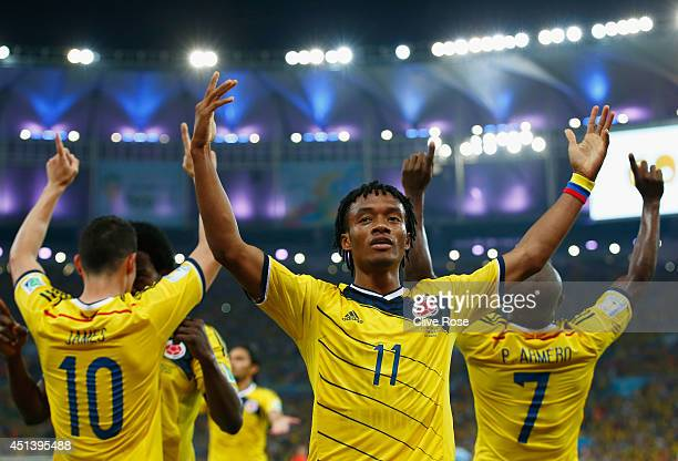 Juan Guillermo Cuadrado of Colombia celebrates his team's second goal scored by James Rodriguez during the 2014 FIFA World Cup Brazil round of 16...