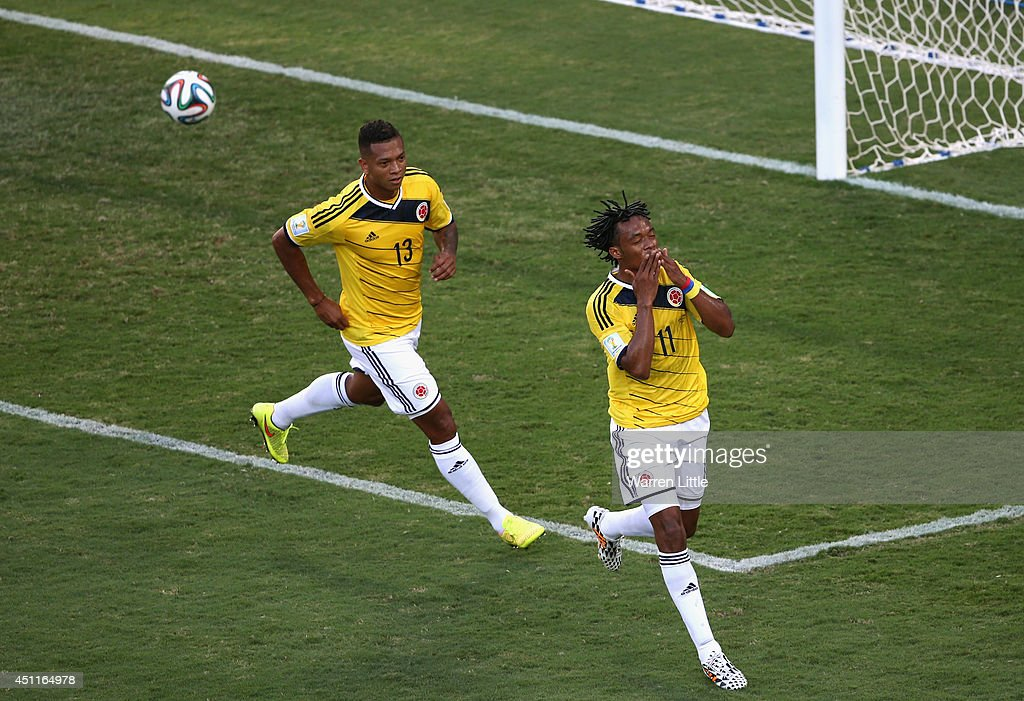 <a gi-track='captionPersonalityLinkClicked' href=/galleries/search?phrase=Juan+Guillermo+Cuadrado&family=editorial&specificpeople=6912738 ng-click='$event.stopPropagation()'>Juan Guillermo Cuadrado</a> of Colombia celebrates scoring his team's first goal after a penalty kick during the 2014 FIFA World Cup Brazil Group C match between Japan and Colombia at Arena Pantanal on June 24, 2014 in Cuiaba, Brazil.