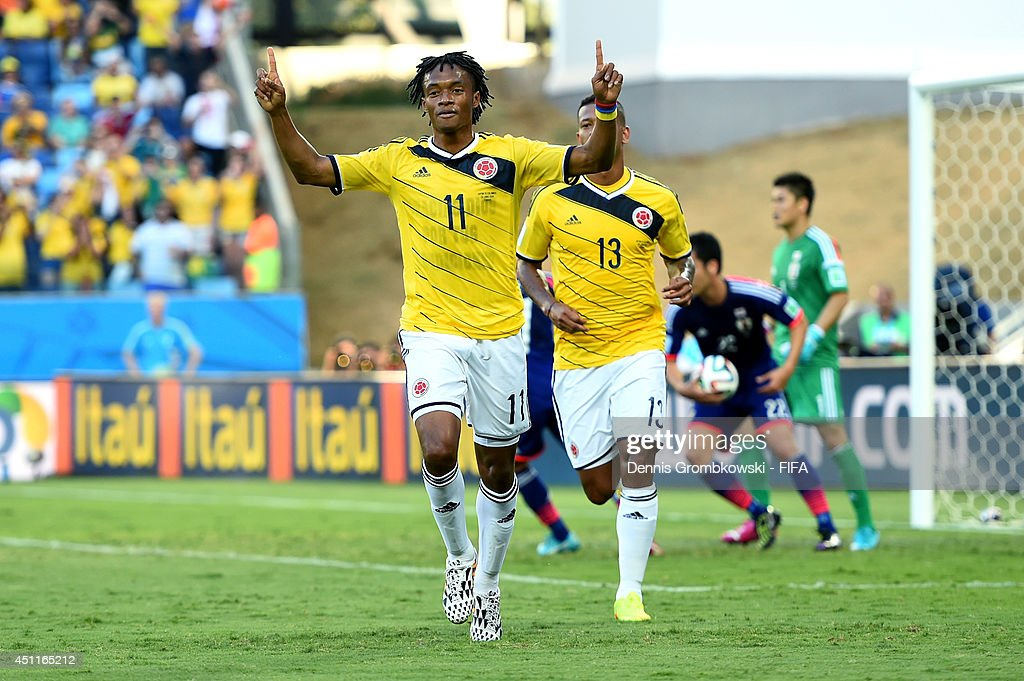 <a gi-track='captionPersonalityLinkClicked' href=/galleries/search?phrase=Juan+Guillermo+Cuadrado&family=editorial&specificpeople=6912738 ng-click='$event.stopPropagation()'>Juan Guillermo Cuadrado</a> of Colombia celebrates scoring his team's first goal from the penalty spot during the 2014 FIFA World Cup Brazil Group C match between Japan and Colombia at Arena Pantanal on June 24, 2014 in Cuiaba, Brazil.