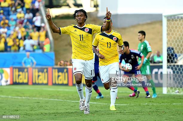 Juan Guillermo Cuadrado of Colombia celebrates scoring his team's first goal from the penalty spot during the 2014 FIFA World Cup Brazil Group C...