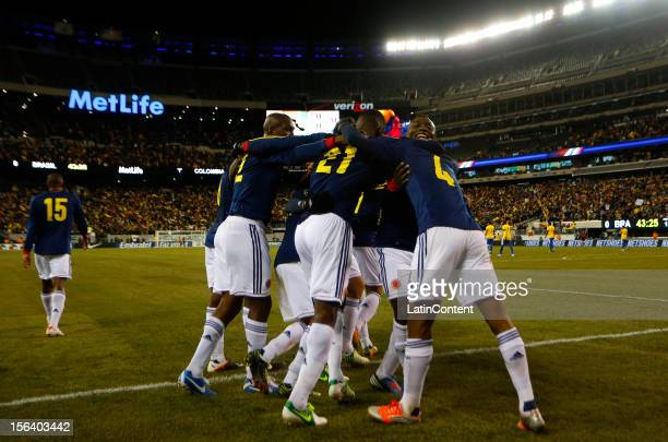 Juan Guillermo Cuadrado of Colombia celebrates with his teammates after his goal against Brazil during a FIFA Friendly match between Colombia and...