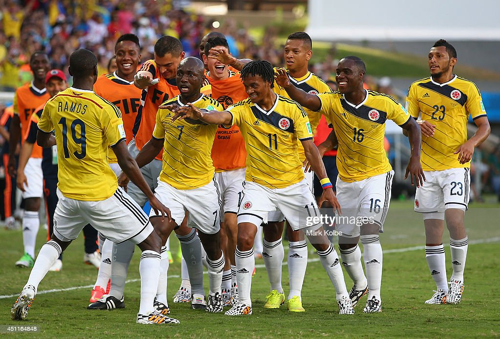 <a gi-track='captionPersonalityLinkClicked' href=/galleries/search?phrase=Juan+Guillermo+Cuadrado&family=editorial&specificpeople=6912738 ng-click='$event.stopPropagation()'>Juan Guillermo Cuadrado</a> of Colombia (center) celebrates with teammates scoring his team's first goal after a penalty kick during the 2014 FIFA World Cup Brazil Group C match between Japan and Colombia at Arena Pantanal on June 24, 2014 in Cuiaba, Brazil.