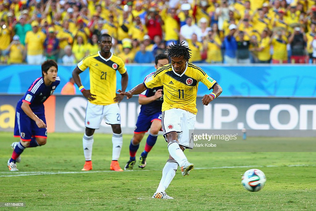 <a gi-track='captionPersonalityLinkClicked' href=/galleries/search?phrase=Juan+Guillermo+Cuadrado&family=editorial&specificpeople=6912738 ng-click='$event.stopPropagation()'>Juan Guillermo Cuadrado</a> of Colombia shoots and scores his team's first goal on a penalty kick during the 2014 FIFA World Cup Brazil Group C match between Japan and Colombia at Arena Pantanal on June 24, 2014 in Cuiaba, Brazil.