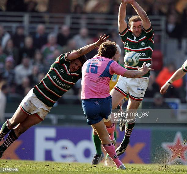 Juan Hernandez the Stade Francais full back has a late drop goal attempt charged down by Harry Ellis and Geordan Murphy during the Heineken Cup...