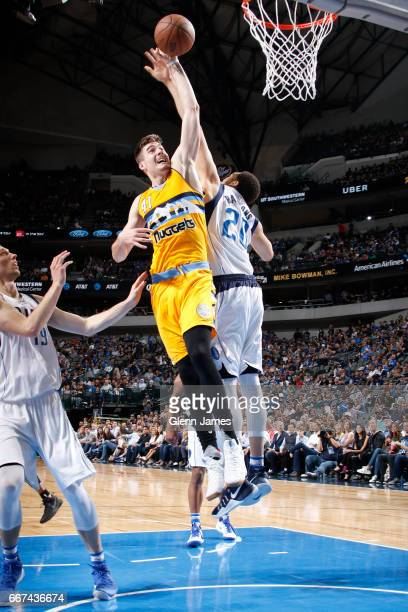 Juan Hernangomez of the Denver Nuggets shoots the ball against the Dallas Mavericks during the game on April 11 2017 at the American Airlines Center...