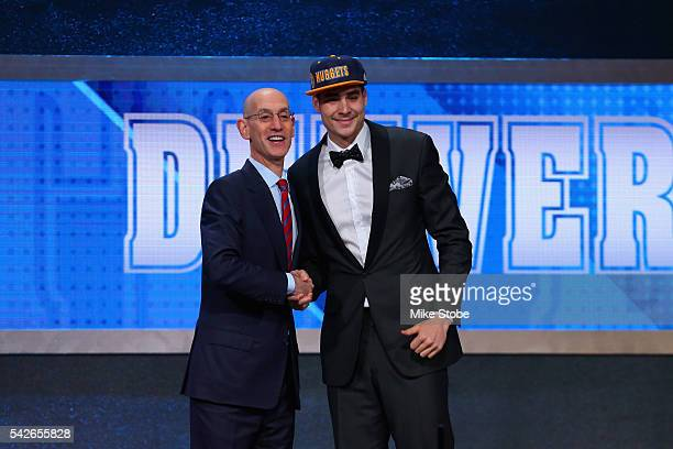 Juan Hernangomez poses with Commissioner Adam Silver after being drafted 15th overall by the Denver Nuggets in the first round of the 2016 NBA Draft...