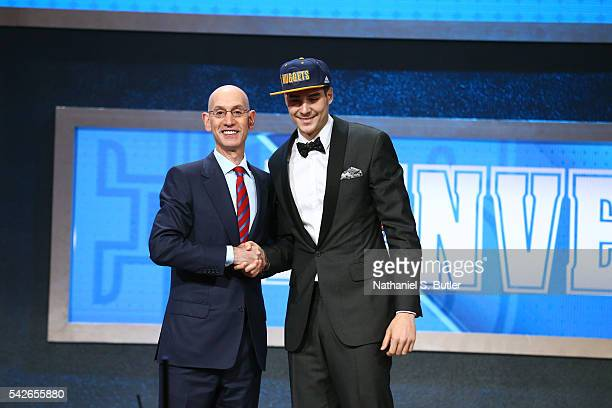 Juan Hernangomez shakes hands with NBA Commissioner Adam Silver after being selected number fifteen overall by the Denver Nuggets during the 2016 NBA...