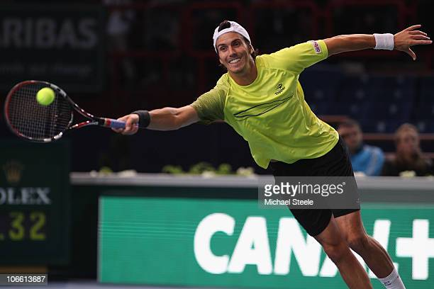 Juan Ignacio Chela of Argentina in action during his match against Ernests Gulbis of Latvia during Day One of the ATP Masters Series Paris at the...