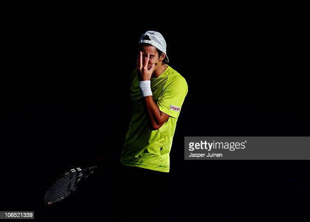 Juan Ignacio Chela of Argentina reacts in his second round match against Nikolay Davydenko of Russia during the ATP 500 World Tour Valencia Open...