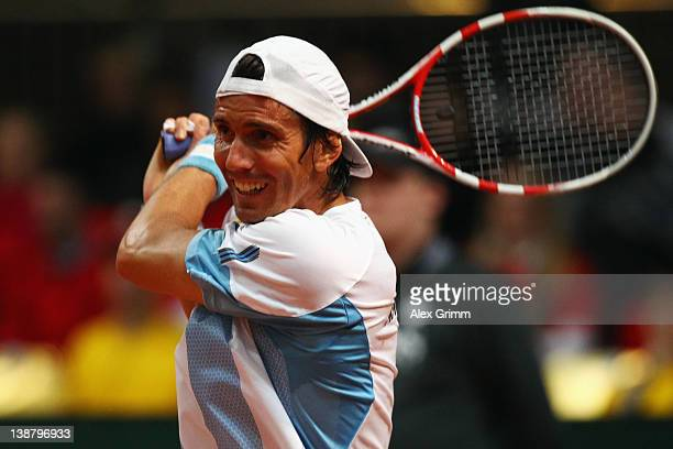 Juan Ignacio Chela of Argentina returns the ball to Florian Mayer of Germany during the Davis Cup World Group first round match between Germany and...
