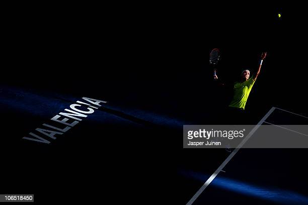 Juan Ignacio Chela of Argentina serves the ball to Nikolay Davydenko of Russia in his second round match during the ATP 500 World Tour Valencia Open...