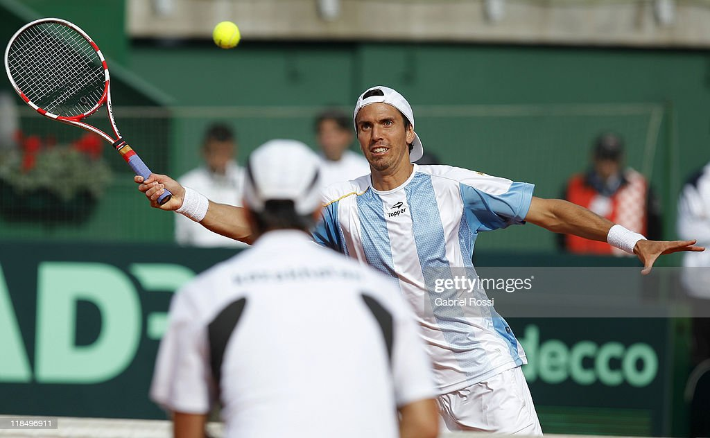 Juan Ignacio Chela of Argentine in action during the match between Argentina and Kazakhstan for second day in the quarters final of the Copa Davis at Parque Roca Stadium on July 08, 2011 in Buenos Aires, Argentina.