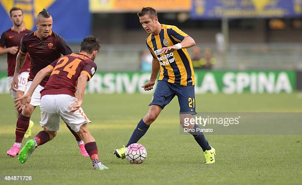 Juan Ignacio Gomez Taleb of Hellas Verona competes with Alessandro Florenzi of AS Roma during the Serie A match between Hellas Verona FC and AS Roma...