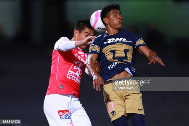 Juan Ignacio Gonzalez of Leon struggles for the ball with Jesus Gallardo of Pumas during the 10th round match between Pumas UNAM and Leon as part of...